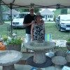 Artist proudly displays her work of cement/hypertufa garden accessories
